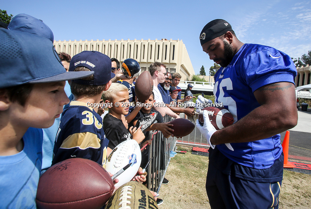 Los Angeles Rams' Cory Harkey signs autographs for fans before the start of trading session at UC Irvine campus.<br /> (Photo by Ringo Chiu/PHOTOFORMULA.com)<br /> <br /> Usage Notes: This content is intended for editorial use only. For other uses, additional clearances may be required.