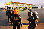 A group of Christian Motorcycle Association riders meet at daybreak in south Oklahoma City prior to riding to a local motorcycle event.