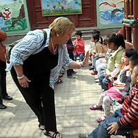 Travcoa Travel Director Jane Vermeulen hosts visit to Chinese kindergarten class.