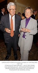 LORD & LADY HOWE at a party in London on 13th May 2002.	OZY 138