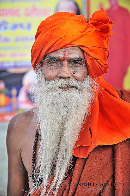 "Sadhu (or Baba) during the Maha Kumbh Mela in Allahabad.....In Hinduism, s?dhu (skt ???? s?dhu, ""good; good man, holy man"") denotes an ascetic, wandering monk. Although the vast majority of s?dhus are yog?s, not all yog?s are s?dhus. The s?dhu is solely dedicated to achieving mok?a (liberation), the fourth and final a?rama (stage of life), through meditation and contemplation of brahman. S?dhus often wear saffron-colored clothing, symbolizing their sany?sa (renunciation)...This way of life is open to women; the female form of the word is s?dhv? ??????"