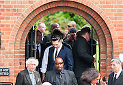 Dave Lee Travis boyfriend of Amy leaves Amy's Winehouse funeral at Golders Green Crematorium July 26.2011... Signer Amy Winehouse who was found dead in her flat on July 23 in London..Tributes have been paid to singer Amy Winehouse, 27, has been found dead at her north London home on July 23rd 2011...A Metropolitan Police spokesman said the cause of Winehouse's death was as yet unexplained...The Brit and Grammy award-winner had struggled with drink and drug addiction and had recently spent time in rehab....