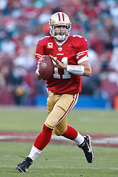 October 10, 2010; San Francisco, CA, USA;  San Francisco 49ers quarterback Alex Smith (11) scrambles out of the pocket against the Philadelphia Eagles during the first quarter at Candlestick Park.