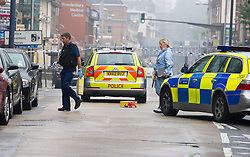 © London News Pictures. 24/08/2013. Kilburn, UK. Police and forensics  at the scene of a double shooting on Kilburn High Road in North London in which two women were shot. One is serenely in critical condition. Photo credit: Ben Cawthra/LNP
