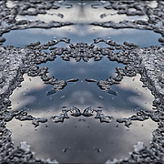 Ice  melted on car surface<br /> <br /> Photographic series of digital computer art from an image of  Ice  melted on car surface.<br /> <br /> Two layers were used, first one mirrored and fliped to second one, to enhance, alter, manipulate the image, creating an abstract surrealistic mirrored symmetry.