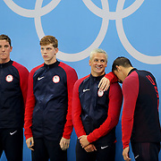 Swimming - Olympics: Day 4   An exhausted  Michael Phelps leans on Ryan Lochte as the United States team including Conor Dwyer and Townley Hass, wait to receive their gold medals for winning the Men's 4 x 200m Freestyle Relay Final during the swimming competition at the Olympic Aquatics Stadium August 9, 2016 in Rio de Janeiro, Brazil. (Photo by Tim Clayton/Corbis via Getty Images)