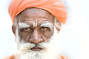 A Hindu mendicant ascetic in an ashram in Pushkar, Rajasthan, India. Orange is a typical colour worn by saddhus (holy men) in India.