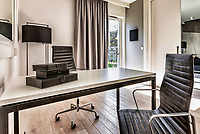 Photo of modern office room in rental business apartment