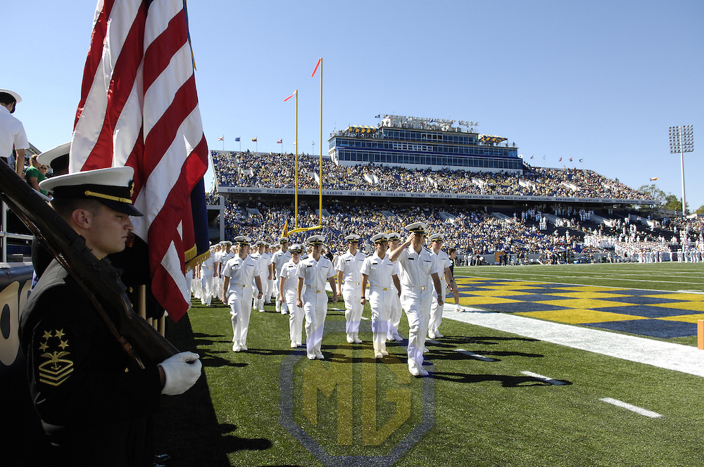 29 September 2007:  The Naval Academy color guard stands at attention as the brigade of Midshipmen march on to the field prior to the start of the game between the Navy Midshipmen and the Air Force Falcons on September 29, 2007.  The Naval Academy Midshipmen defeated the Air Force Falcons 31-20 at Navy Marine Corps Memorial Stadium in Annapolis, MD.