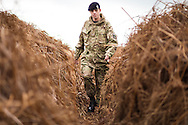 A soldier walks through an overgrown trench in a practice battlefield, where thousands of troops trained before embarking for the battlefields of Europe during World War One. The trench system was been discovered by chance on the Browndown Ministry of Defence site in Gosport, Hampshire, England. March 6, 2014. AFP PHOTO / CHRIS ISON.