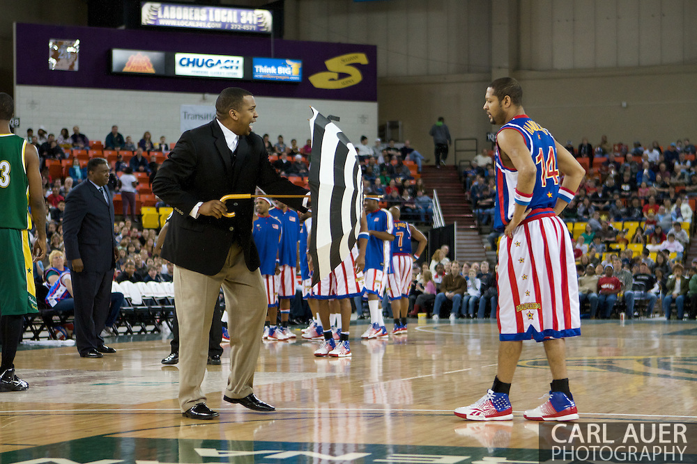 April 30th, 2010 - Anchorage, Alaska:  Trying anything to get an edge, the Washington Generals coach attempts to hypnotize Globetrotter Handles Franklin (14) during the game at the Sullivan Arena Friday night.