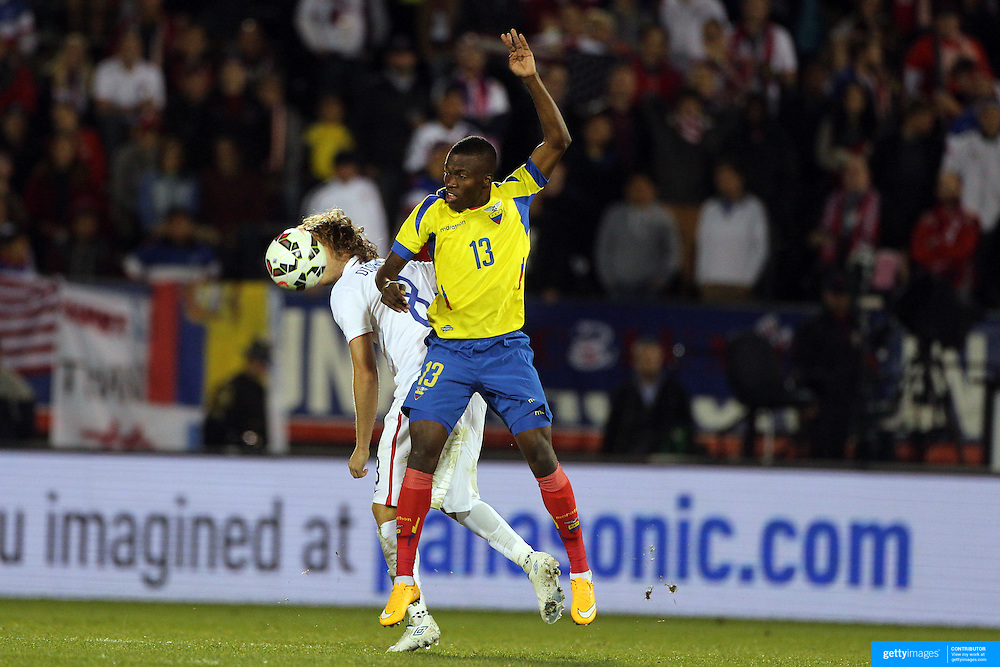 Enner Valencia, Ecuador, is challenged by Mix Diskerud, USA, during the USA Vs Ecuador International match at Rentschler Field, Hartford, Connecticut. USA. 10th October 2014. Photo Tim Clayton
