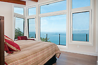 The view from this master bedroom looks out to the Pacific Ocean.