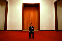 epa06270817 A Chinese security officer guard an entrance in the Great Hall of the People (GHOP) where the 19th National Congress of the Communist Party of China (CPC) will be held in Beijing, China, 17 October 2017. The five-yearly 19th National Congress of the Communist Party of China (CPC) will begin on 18 October.  EPA-EFE/HOW HWEE YOUNG