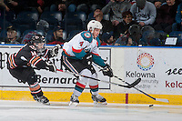 KELOWNA, CANADA - FEBRUARY 1: Lucas Cullen #14 of the Calgary Hitmen stick checks Gordie Ballhorn #4 of the Kelowna Rockets as he skates with the puck on February 1, 2017 at Prospera Place in Kelowna, British Columbia, Canada.  (Photo by Marissa Baecker/Shoot the Breeze)  *** Local Caption ***