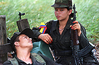 A FARC rebel couple in a camp just outside of San Vicente del Caguan in the former FARC controlled zone of Colombia. The FARC are Colombia's oldest and largest rebel group numbering over 18,000 rebels. (Photo/Scott Dalton)