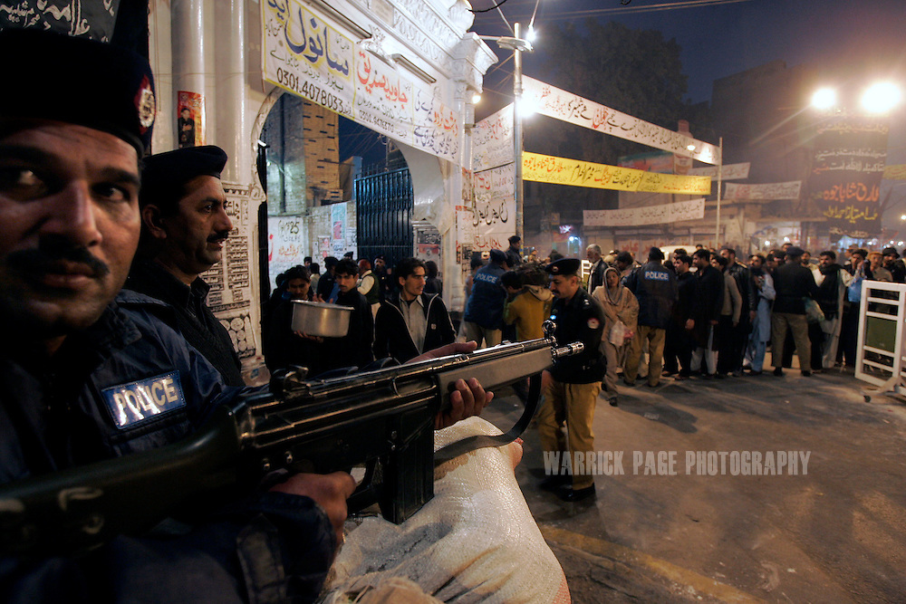 LAHORE, PAKISTAN - JANUARY 29: Police guard the entrance to a mosque in the Old City, Lahore, Pakistan on Monday 29 January, 2007. Shiite Muslims around the world commemorate the martyrdom of the Prophet Mohammed's grandson, Imam Hussein, who was killed during the battle of Karbala, Iraq. Security has been increased throughout Pakistan due to fears of sectarian violence after suicide bombings in Islamabad and Peshawar last week claimed the lives of 15 people. (Photo by Warrick Page)