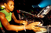 DJ Sonique DJing wearing tasteless sleeveless green top and tattoos on show, London, U.K, 2000.