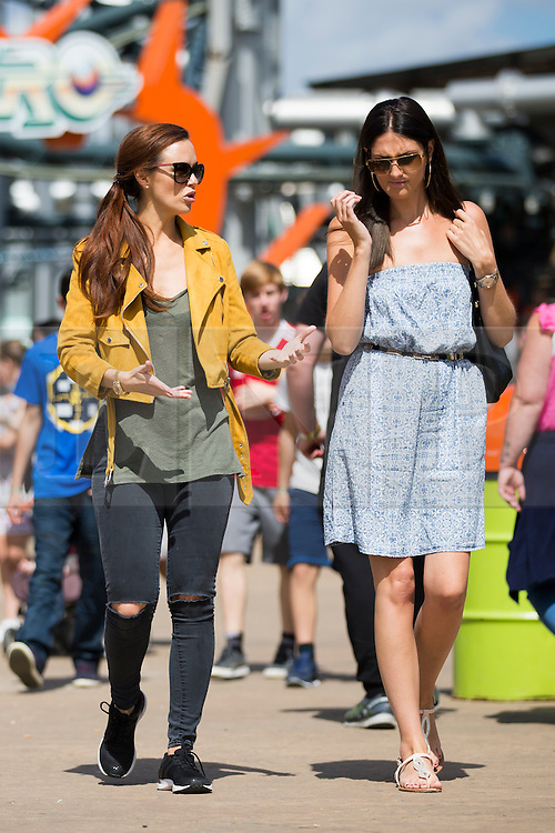 © Licensed to London News Pictures. 07/08/2016. Malton UK. Picture shows Hollyoaks actress Jennifer Metcalfe walking with a friend on a day out at Flamingo land in Yorkshire. The actress who plays Mercedes McQueen in the soap was accompanied by her partner & former Geordie Shore star Greg Lake. Jennifer was at Flamingo Land to launch a new restaurant at the adventure park called Fabrizio's. Photo credit: Andrew McCaren/LNP