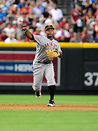 Apr. 17 2011; Phoenix, AZ, USA; San Francisco Giants shortstop Miguel Tejada (10) makes a play at first base against the Arizona Diamondbacks at Chase Field. The Diamondbacks defeated the Giants 6-5 in extra innings. Mandatory Credit: Jennifer Stewart-US PRESSWIRE..