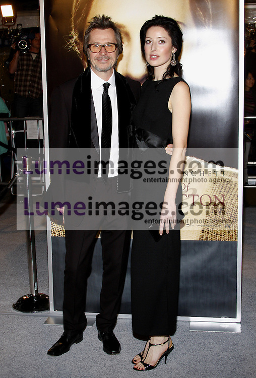 Gary Oldman and Alexandra Edenborough at the Los Angeles premiere of 'The Curious Case Of Benjamin Button' held at the Mann's Village Theater  in Westwood on December 8, 2008. Credit: Lumeimages.com