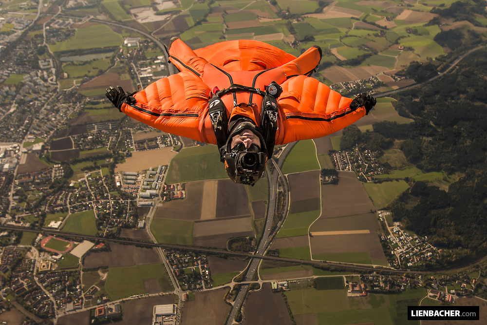 Jarno Cordia is flying his Wingsuit over Wels during a photo jump