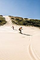Digi sandboarding on the dunes of Campo Bom Beach. Jaguaruna, Santa Catarina, Brazil. / <br /> Digi andando de sandboard nas dunas da Praia de Campo Bom. Jaguaruna, Santa Catarina, Brasil.