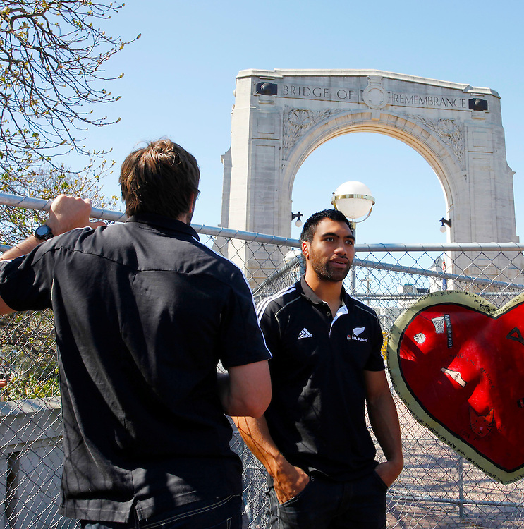 All Black Victor Vito, right,  in front of the Bridge of Remembrance, viewing earthquake damage, during the All Blacks visit to Christchurch, New Zealand, Sunday, September 18, 2011.  Credit:SNPA / Pam Johnson