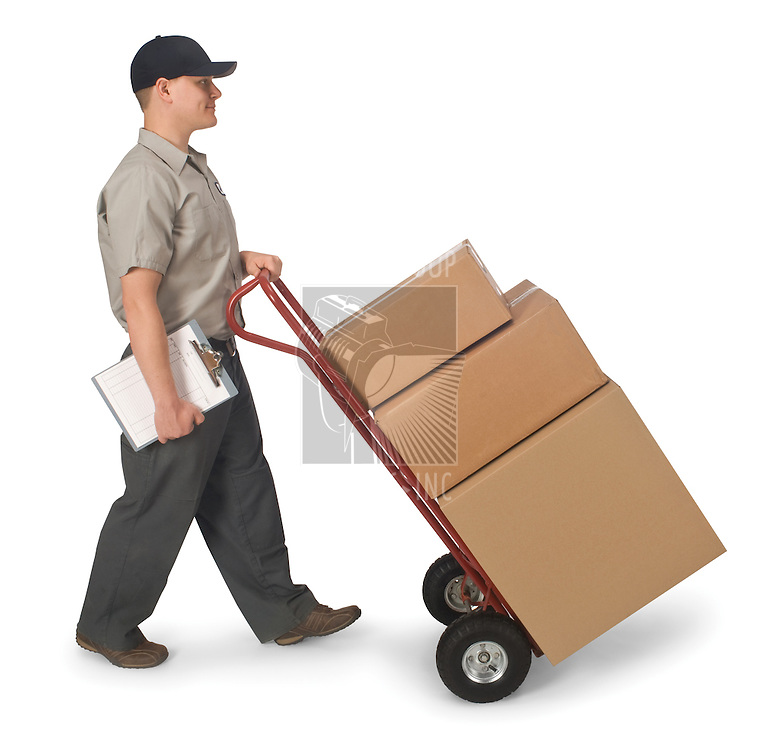 Delivery man pushing hand truck with boxes, isolated on a white background with clipping path