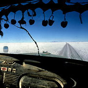 Cabin  truck.  Salar de Uyuni ( Uyuni salt flat ) . Department  of Potos&Atilde;&shy;  ( Los Lipez).  South West  Bolivia. <br /> Adult Altiplano America Andes Arid  Aridity  Barren  Bolivia Cabin Color Colour  Day Daytime Decoration  Department  Desert Desolate Desolation Dry  Exterior Extraction  Geography Hack Hard  Heat Highlands  Horizon Horizontal Human  Latin America Lake  Los Lipez Lorry Miner Mining Nature  Resource Road  Natural  One Outdoors Outside  Pan  Potos&Atilde;&shy;  Production  Region Resource Rural Salar de Uyuni  Salt Flat  Salt Pan  Salt lake  Scenic Seasoning  Single Shape South America  Southwest  Sud Sunglasses  Surface Track Travel  Way West White