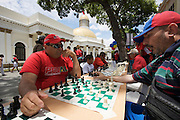 Supporters of Hugo Chavez celebrating the sixth anniversary of the failed coup against Chavez in the historic Center of Caracas. Playing chess in front of Capitolio Nacional.