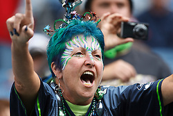 September 12, 2010; Seattle, WA, USA;  A Seattle Seahawks fan cheers her team on before the game against the San Francisco 49ers at Qwest Field.
