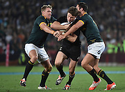 JOHANNESBURG, South Africa, 04 October 2014 : Beauden Barrett of the All Blacks is tackled by Jean de Villiers (C) and Jan Serfontein of the Springboks during the Castle Lager Rugby Championship test match between SOUTH AFRICA and NEW ZEALAND at ELLIS PARK in Johannesburg, South Africa on 04 October 2014. <br /> The Springboks won 27-25 but the All Blacks successfully defended the 2014 Championship trophy.<br /> <br /> © Anton de Villiers / SASPA