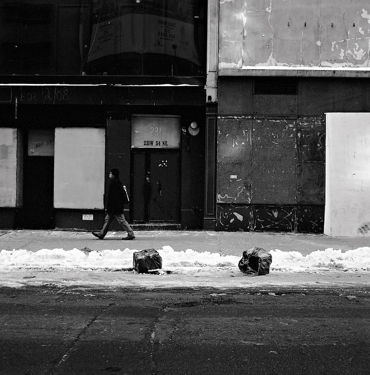 Man walking past empty buildings, Midtown, Manhattan