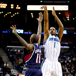 December 26, 2010; New Orleans, LA, USA; New Orleans Hornets small forward Trevor Ariza (1) shoots over Atlanta Hawks guard Jamal Crawford (11) during the first quarter at the New Orleans Arena.  Mandatory Credit: Derick E. Hingle