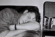 Boy sleeping during a house party, UK, 1987.