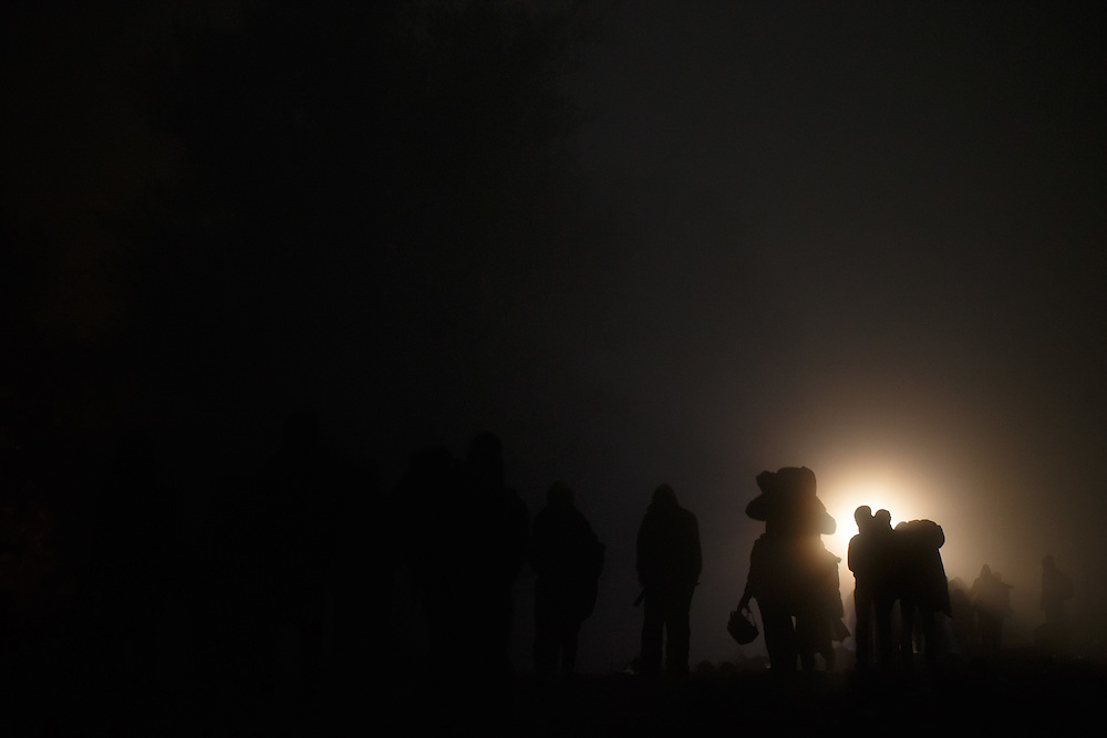 26.10.2015, refugees walking through the fields after crossing border over the bridge between Slovenia in Croatia  to reach open air waiting point  where they must wait for the room in the reception centers in Rigonce, Dobova and Brezice.