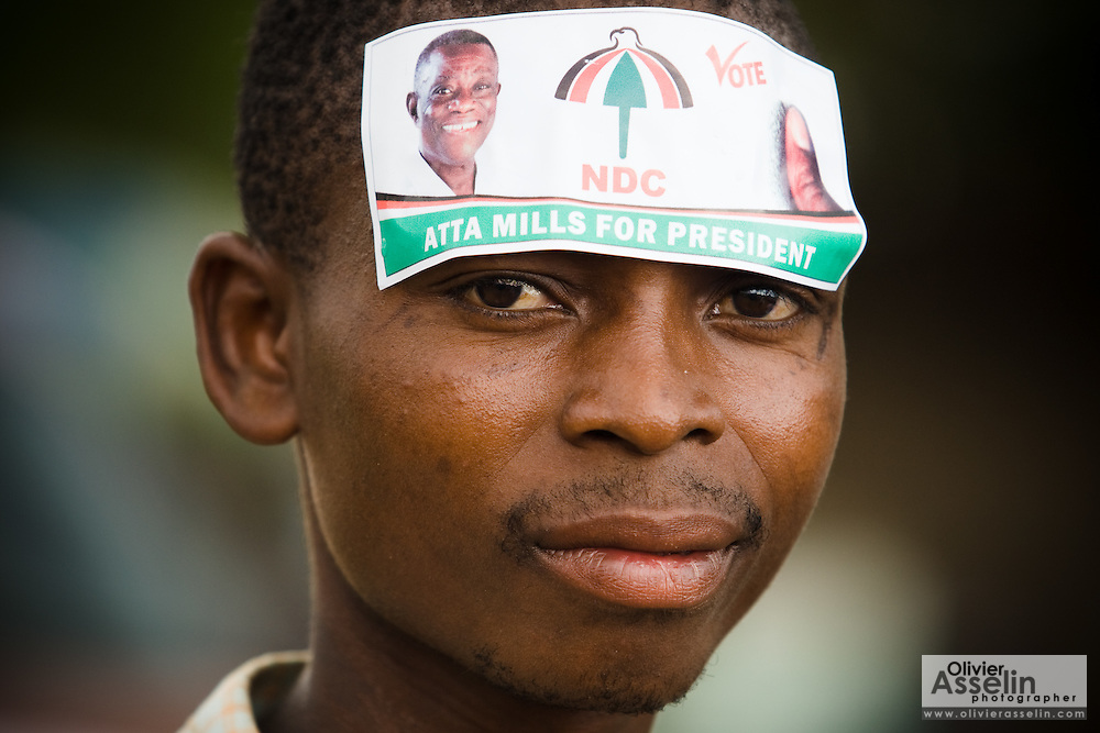 A man wears a sticker on his forehead to show support for opposition leader John Atta Mills, of the National Democratic Congress (NDC), during a rally in Tema, roughly 30km east of Ghana's capital Accra on Friday December 5, 2008. Ghanaians are voting in a presidential election on December 7 as incumbent John Agyekum Kufuor, leader of the New Patriotic Party (NPP),  is to step down after ruling for 2 consecutive 4-year terms.