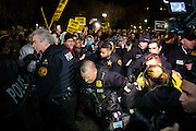 Secret Service members rush an arrested man through a crowd after a fight broke out in front of the White House during an anti-Trump protest on the evening of Nov. 9, 2016. Police closed La Fayette Plaza after the incident, where one man was arrested.