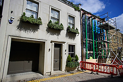 © London News Pictures. 27/04/2016. A house painted with red and white stripes in the Kensington area of west London which is currently being demolished and then rebuilt. The candy stripes were originally painted on to the multi-million pound house following a dispute in which  neighbours objected to plans to demolish the building and replace it with a new house and two-storey basement. Photo credit: Ben Cawthra/LNP