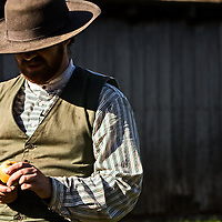 Farmer working on Firestone Farm at Greenfield Village. Photography by KMS Photography