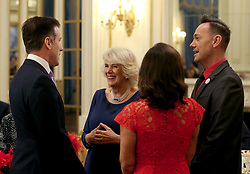 December 23, 2017 - London, London, United Kingdom - Image licensed to i-Images Picture Agency. 22/12/2017. London, United Kingdom. The Duchess of Cornwall, President of the National Osteoporosis Society, talks to 'Strictly Come Dancing' dancer Anton du Beke (left) with judges Shirley Ballas and Craig Revel Horwood as she hosts a tea dance at Buckingham Palace in London attended by 'Strictly Come Dancing' dancers and judges to highlight the benefits for older people of staying active. (Credit Image: © Rota/i-Images via ZUMA Press)