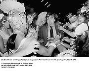 Dudley Moore arriving at Vanity Fair magazine's Phoenix House benefit. Los Angeles. March 1990.<br />