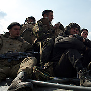 KRAMATORSK, UKRAINE - April 16, 2014: A column of Ukrainian military men riding on armoured personnel carriers and tanks are blocked by pro-Russia activists in the eastern Ukrainian city of Kramatorsk, in the Donetsk region.