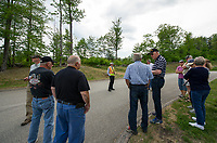 Residents gather at the end of Sterling Drive across the street from the capped landfill to meet with city planners and New England Solar Garden to discuss the proposed solar panel project on Friday afternoon.  (Karen Bobotas/for the Laconia Daily Sun)