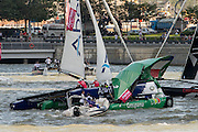 Team Aberdeen Singapore crashes down onto Groupama taking down the rig and injuring sailor Tanguy Cariou. Day three of the Extreme Sailing Series regatta being sailed in Singapore. 22/2/2014