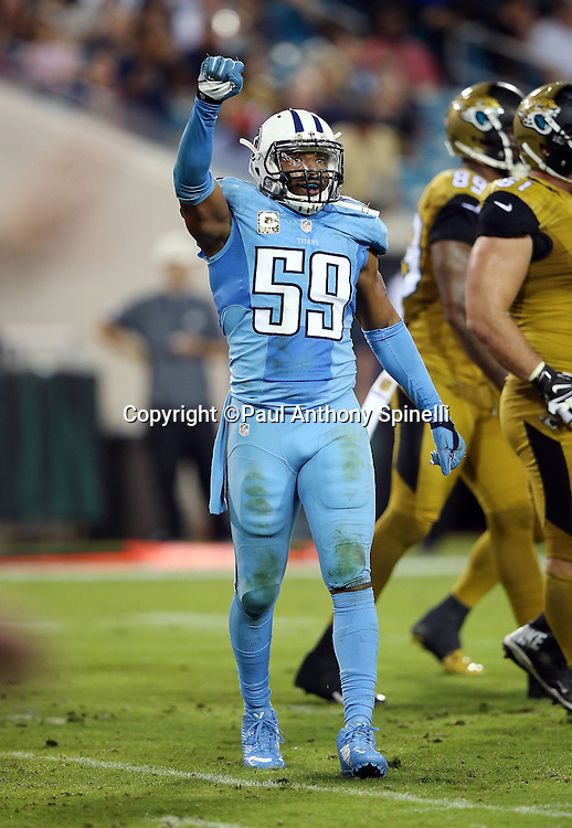 Tennessee Titans inside linebacker Wesley Woodyard (59) holds his fist in the air signaling fourth down during the 2015 week 11 regular season NFL football game against the Jacksonville Jaguars on Thursday, Nov. 19, 2015 in Jacksonville, Fla. The Jaguars won the game 19-13. (©Paul Anthony Spinelli)