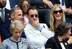 Royal Box guests (left-right) Mark Carney, Jude Law and Phillipa Coan on day eleven of the Wimbledon Championships at the All England Lawn Tennis and Croquet Club, Wimbledon.