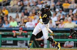 Jun 15, 2018; Pittsburgh, PA, USA; Pittsburgh Pirates right fielder Gregory Polanco (25) grounds out for a sacrifice RBI during the second inning against the Cincinnati Reds at PNC Park. Mandatory Credit: Ben Queen-USA TODAY Sports