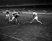 01/11/1970<br /> 11/01/1970<br /> 1 November 1970<br /> All-Ireland Under-21 Hurling Final: Cork v Wexford at Croke Park, Dublin. <br /> S. O'Leary, Cork forward, brings in a fast ball in the hope of scoring Cork's first goal; however, L. Bennett of Wexford was there to  stop him.